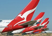 Photo of Qantas flags $2b loss, pushes for international travel late this year